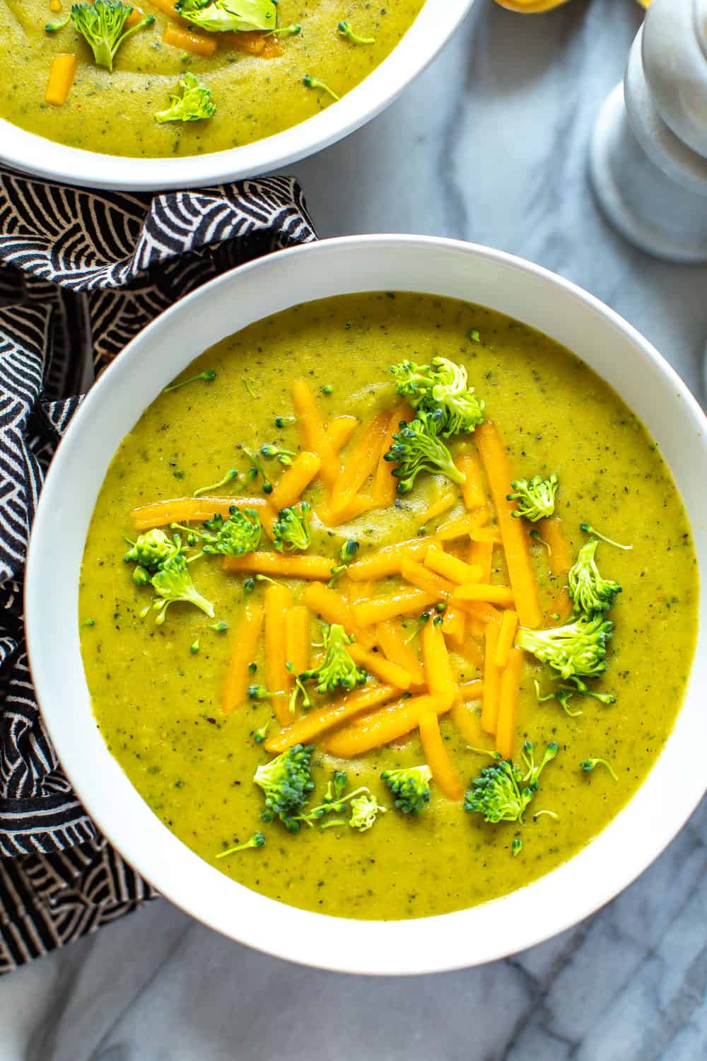 a bowl of creamy broccoli cheddar soup, made in an Instant Pot