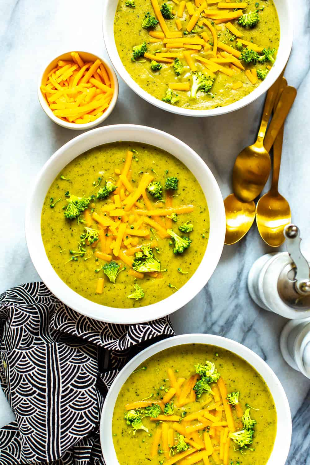 bowls of broccoli cheddar soup made in a pressure cooker