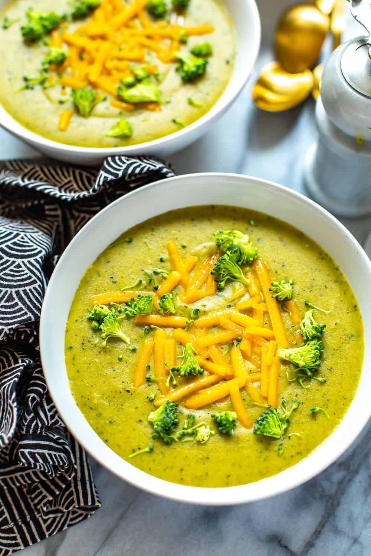 cheesy broccoli soup in a white bowl