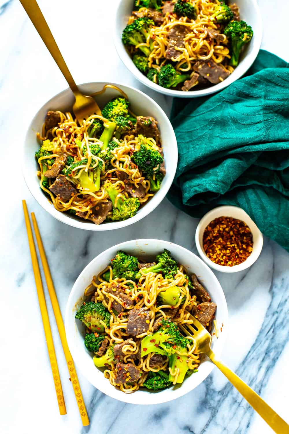 stir fry beef with broccoli served in bowls