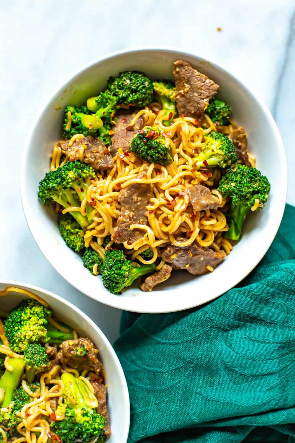 Asian beef with broccoli in a white bowl