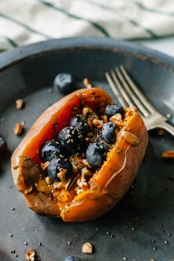 healthy breakfast - stuffed sweet potatoes with fruit and oats