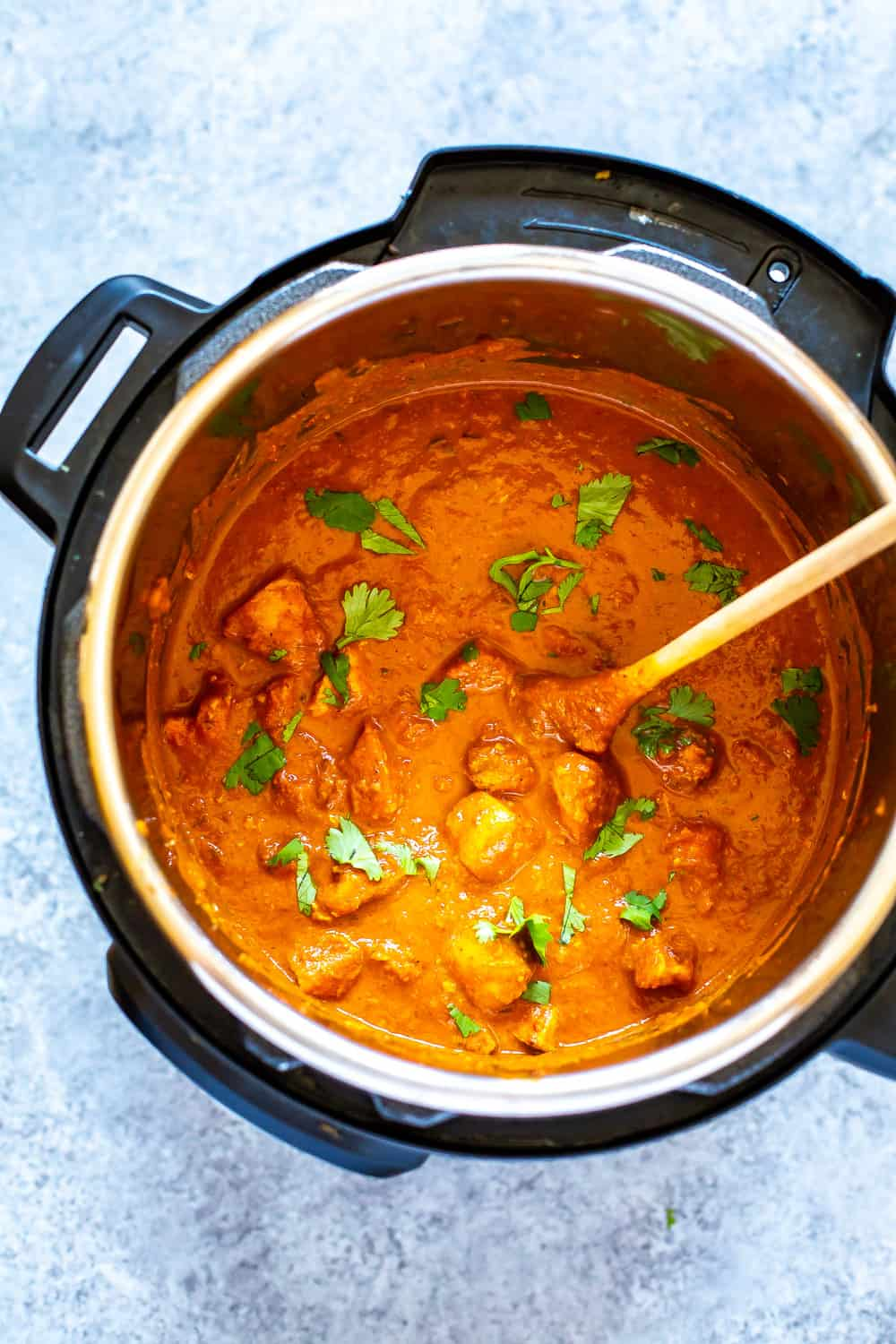 Indian butter chicken cooking in an Instant Pot
