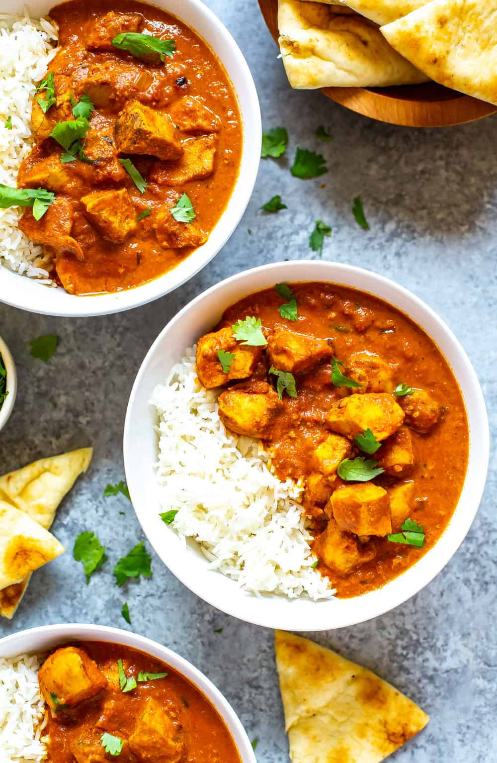 bowls of Instant Pot Butter Chicken on white rice