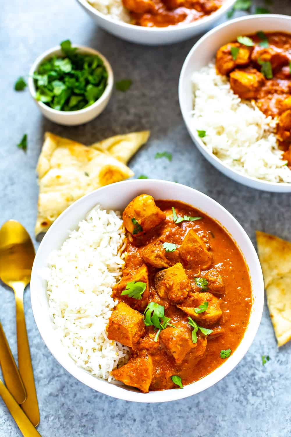 Indian curry chicken dinner in white bowl with rice