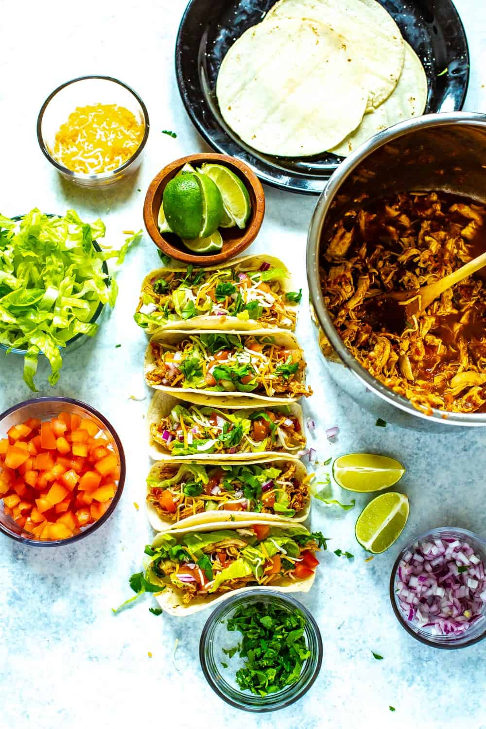 Chicken Tacos next to Instant Pot taco chicken