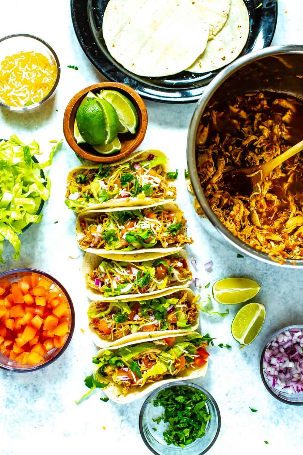 Instant Pot Chicken Tacos dinner with toppings in bowls