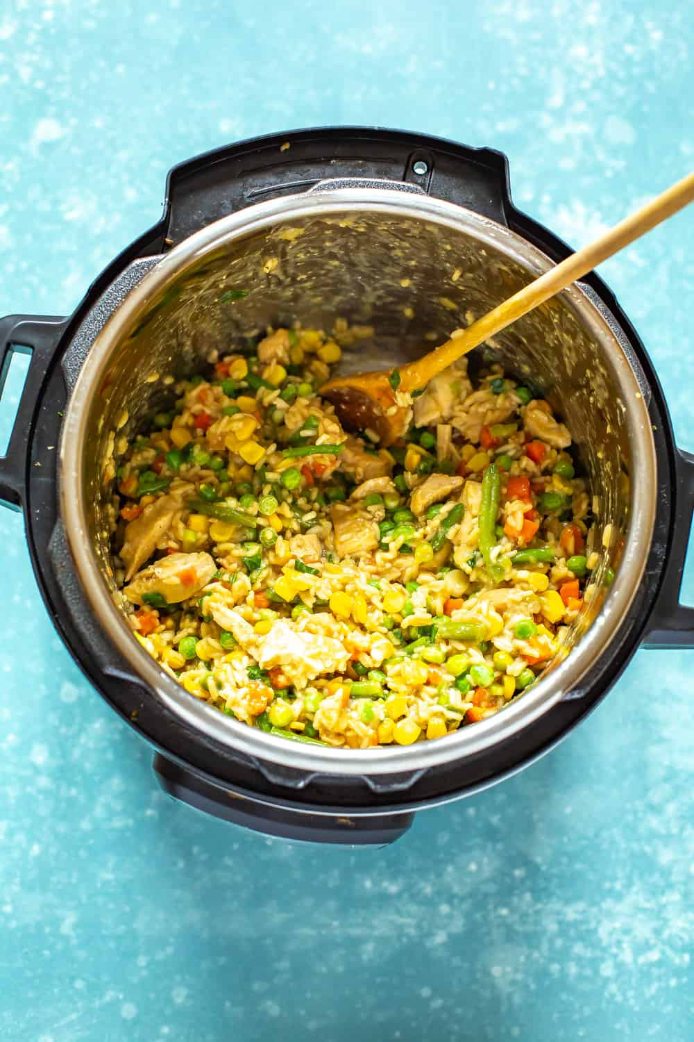 making an Instant Pot Chicken Fried Rice recipe in a pressure cooker
