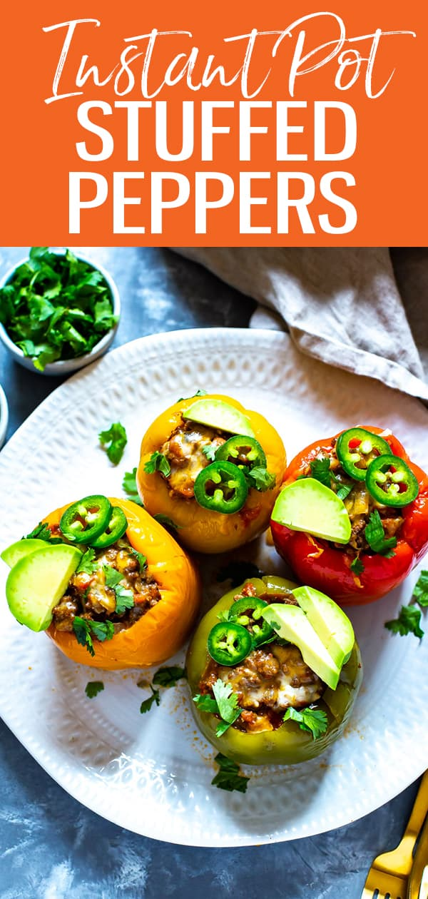 These Instant Pot Stuffed Peppers with ground beef are a delicious, low-carb option with a Mexican twist. Perfect for busy weeknights because this recipe minimizes clean up too! #instantpot #stuffedpeppers