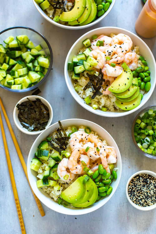 rice bowls with shrimp, avocado, and cucumber